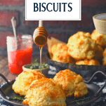 Drizzling honey on fluffy cheese biscuits with text title overlay