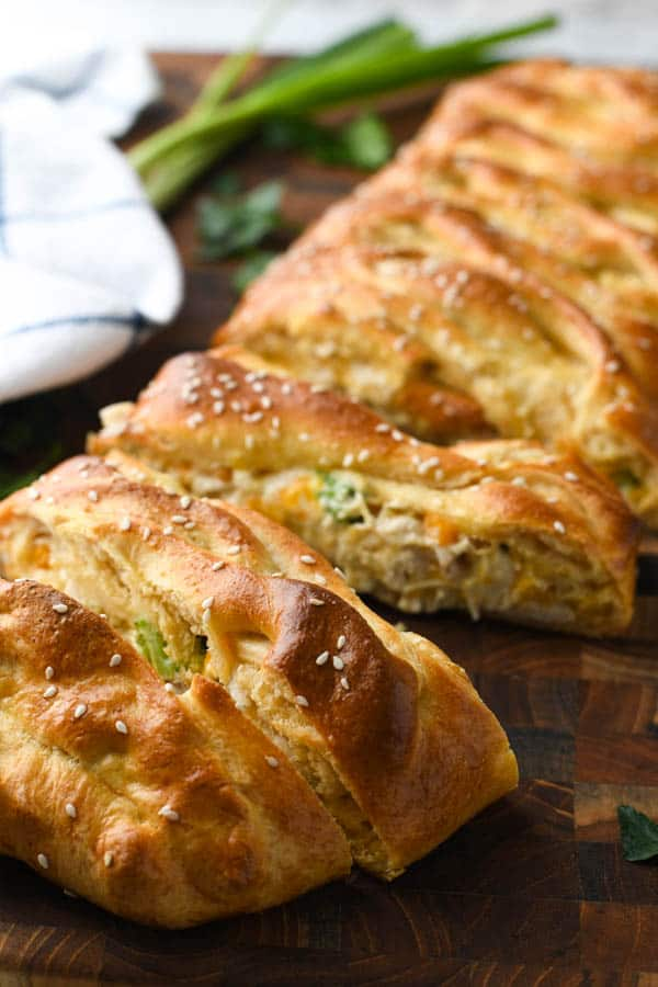 Close up side shot of a sliced chicken broccoli crescent braid