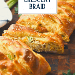 Sliced chicken broccoli crescent braid on a wooden board with text title overlay