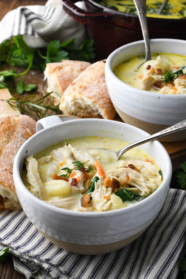 Front shot of two bowls of creamy chicken gnocchi soup