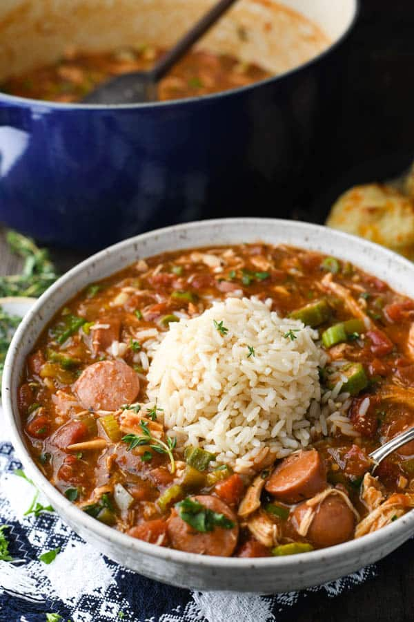 Close up shot of Louisiana chicken and sausage gumbo in a white bowl