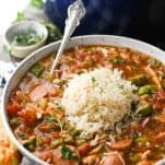 Close up side shot of chicken and sausage gumbo in a large serving bowl