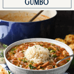 Front shot of easy gumbo recipe in a white serving bowl with text title box at top