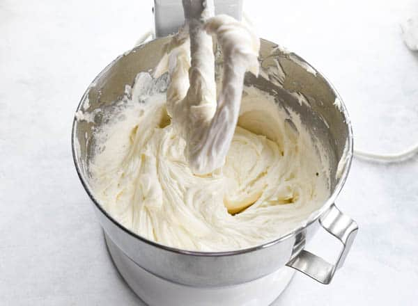Process shot showing how to make easy coconut cake frosting