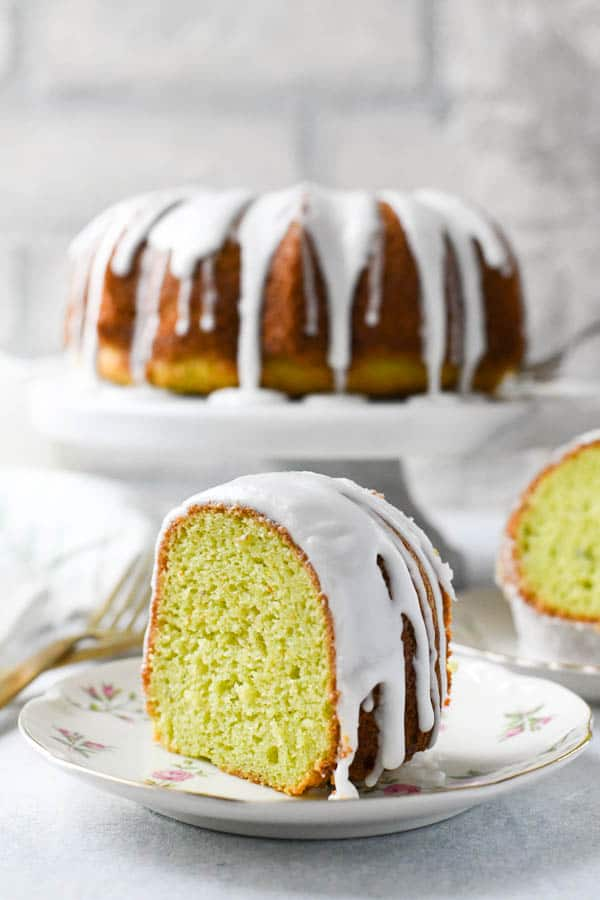 Front shot of a slice of pistachio bundt cake on a small plate
