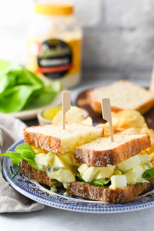 The best egg salad sandwich recipe served on a blue and white plate