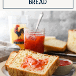 Toasted no knead bread on a plate with text title box at top