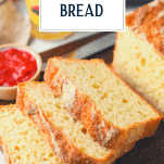 Sliced English muffin loaf bread with text title overlay