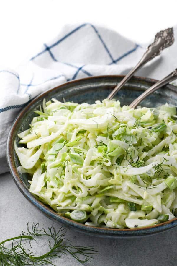 Side shot of a bowl of fennel salad