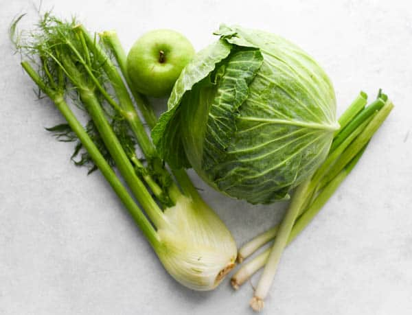 Process shot showing how to make cabbage fennel salad