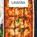 A dish of three cheese homemade lasagna with text title box at top