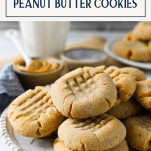 Side shot of a plate of the best peanut butter cookie recipe with text title box at top