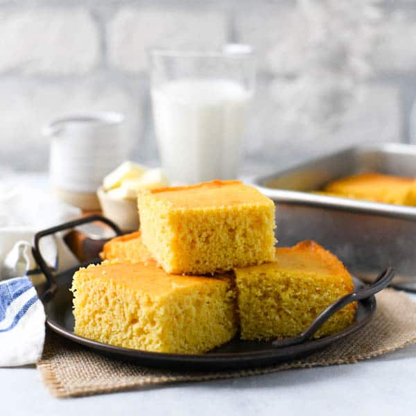 Square image of a tray of the best honey cornbread recipe