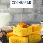 Drizzling honey over cornbread with text title overlay