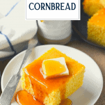 Square of honey cornbread on a plate with text title overlay