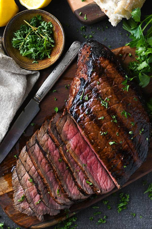 Overhead shot of grilled london broil on a cutting board