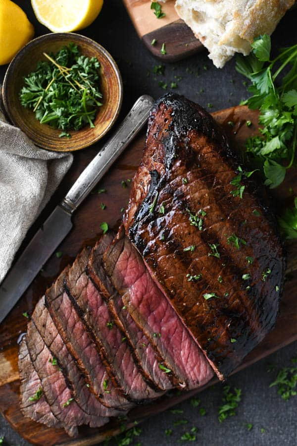 Overhead shot of sliced london broil on a cutting board