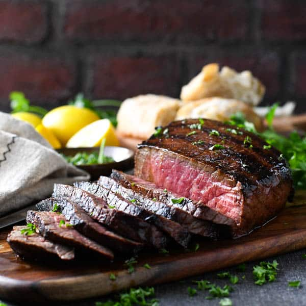 Horizontal shot of a grilled and sliced marinated london broil