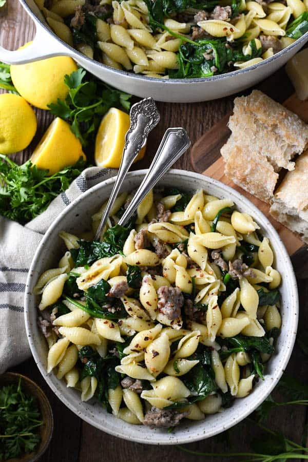 Overhead shot of a bowl of pasta with Italian sausage and spinach