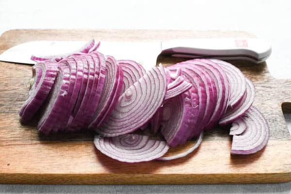 Sliced red onions on a cutting board