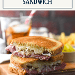 The best reuben sandwich recipe served on a wooden cutting board with text title box at top