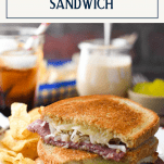 Homemade reuben sandwich on a plate with chips and text title box at the top