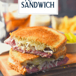 Close up shot of a classic reuben sandwich on a wooden cutting board with text title overlay