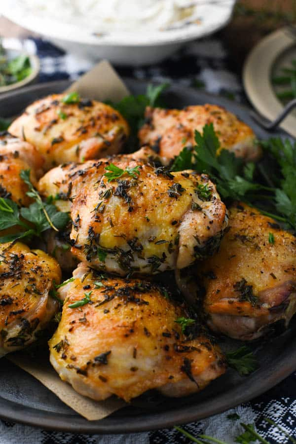 Platter of the best garlic and herb chicken thighs