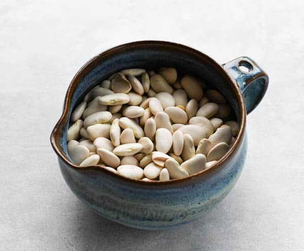 Large dried lima beans in a bowl