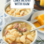 Front shot of two bowls of lima beans with ham and text title overlay