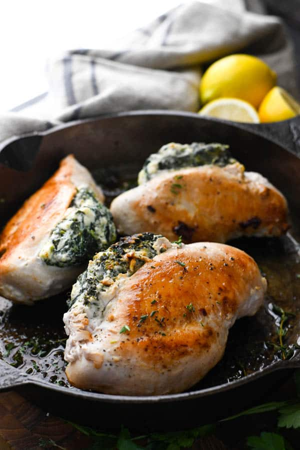 Stuffed chicken with cream cheese and spinach in a cast iron skillet
