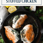Overhead shot of spinach and cheese stuffed chicken breast with text title box at top