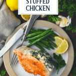Overhead shot of a plate of spinach stuffed chicken breast with text title overlay