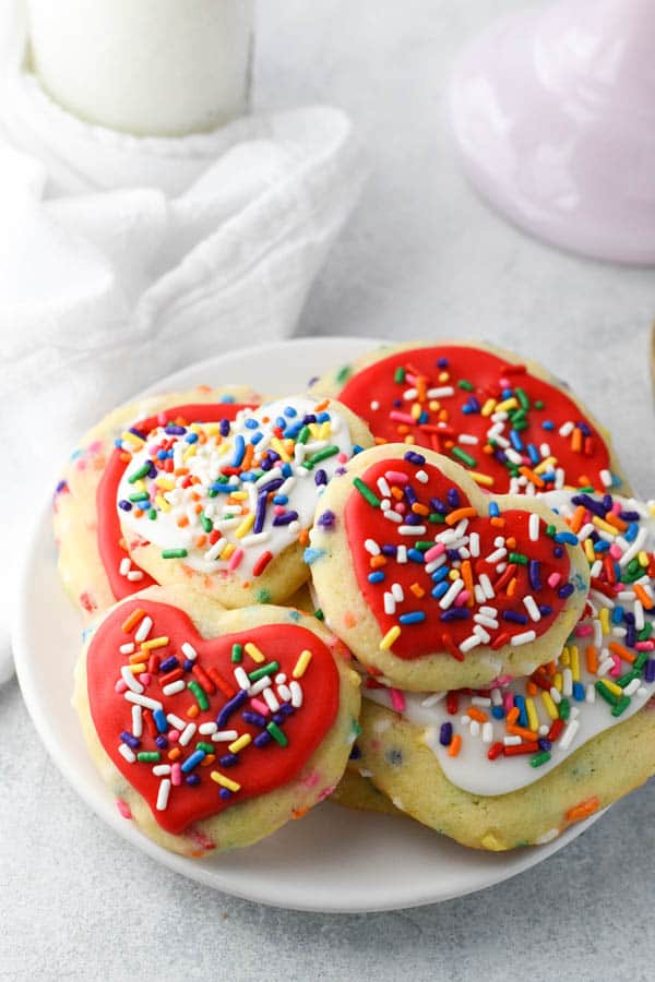 Plate of sugar sprinkle cookies with frosting