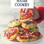 Child picking up heart shaped sugar cookie with rainbow sprinkles and text title overlay