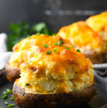 Side shot of a twice baked potatoes on a serving platter