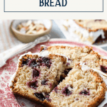 Piece of cherry almond bread on a red and white plate with text title box at top