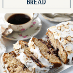 Sliced loaf of almond cherry bread with text title box at top