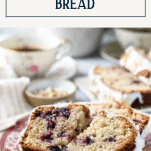 Slice of fresh cherry loaf cake with text title box at top