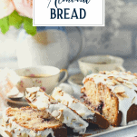 Loaf of cherry almond cake with text title overlay