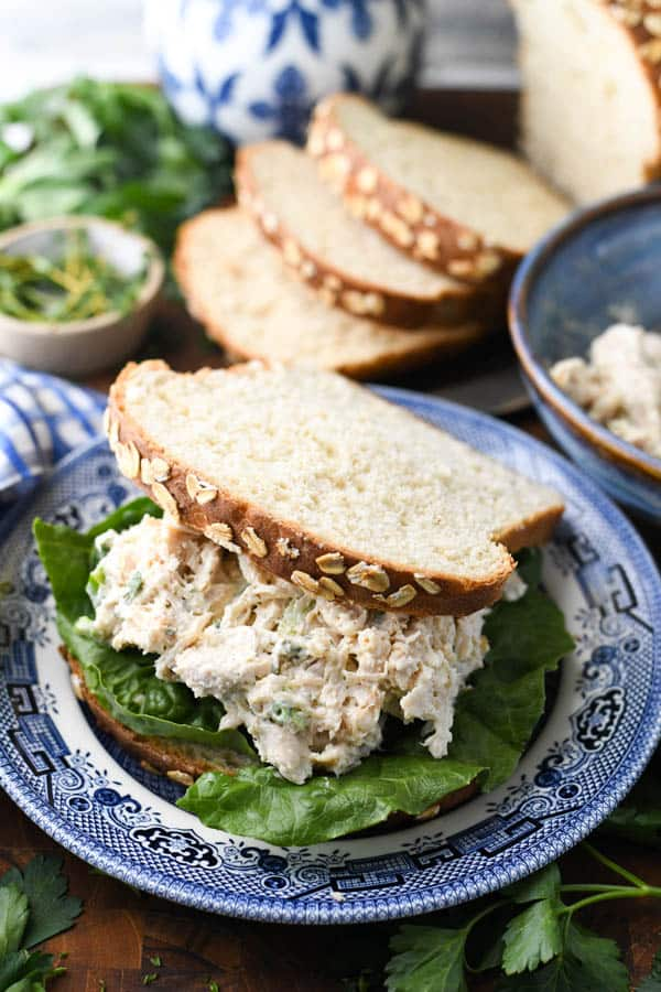 Chicken salad sandwich on a blue and white plate