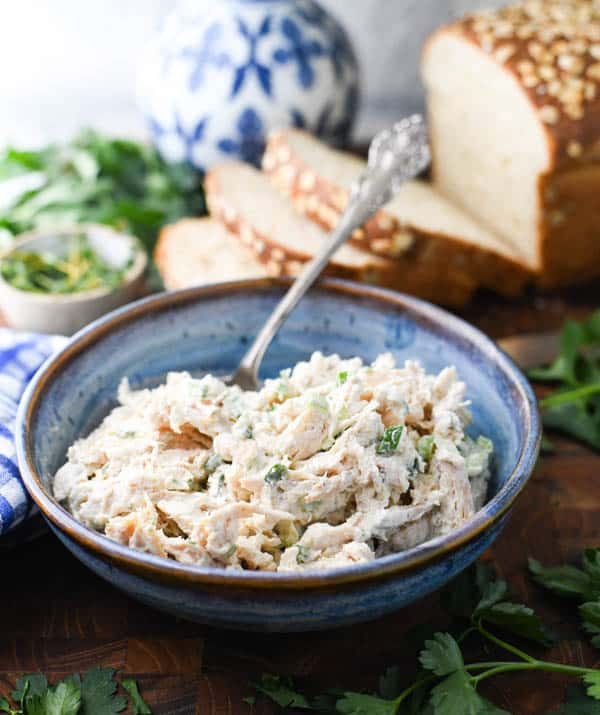 Side shot of easy chicken salad recipe in a blue serving bowl