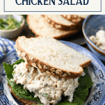 Close up shot of a chicken salad sandwich on homemade bread with text title box at top