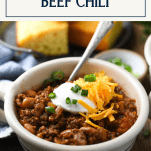 Side shot of a bowl of the best chili recipe with a text title box at the top