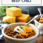 Spoon in a bowl of easy chili with a text title box at the top