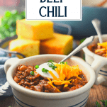 Side shot of a bowl of the best beef chili recipe with a text title overlay