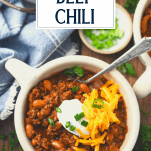 Overhead shot of a bowl of the best chili recipe with text title overlay