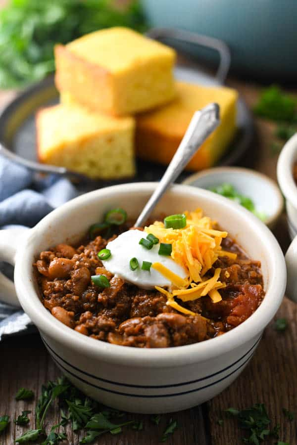 Front shot of a bowl of the best chili recipe in a blue and white bowl