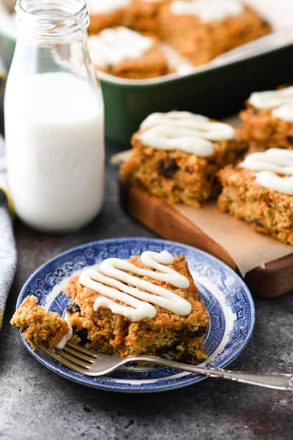 Front shot of a carrot oatmeal bar on a plate with a fork.