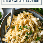 Close overhead image of a bowl of chicken alfredo bake with text title box at top